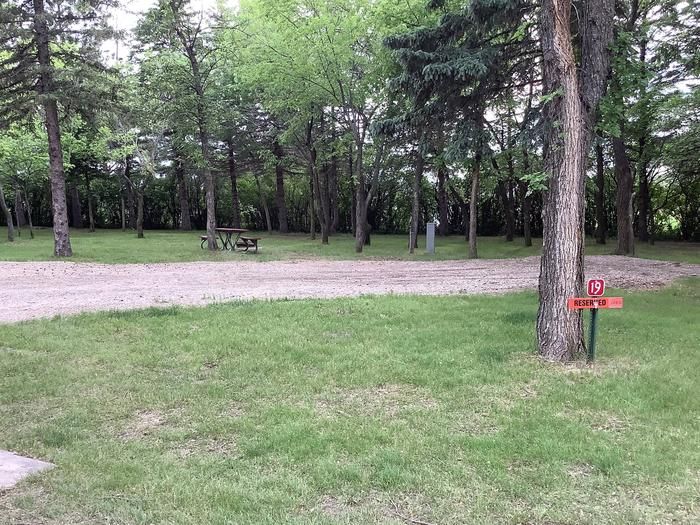 Well shaded site. Works well for longer campers with slides. Near playground.Site 19