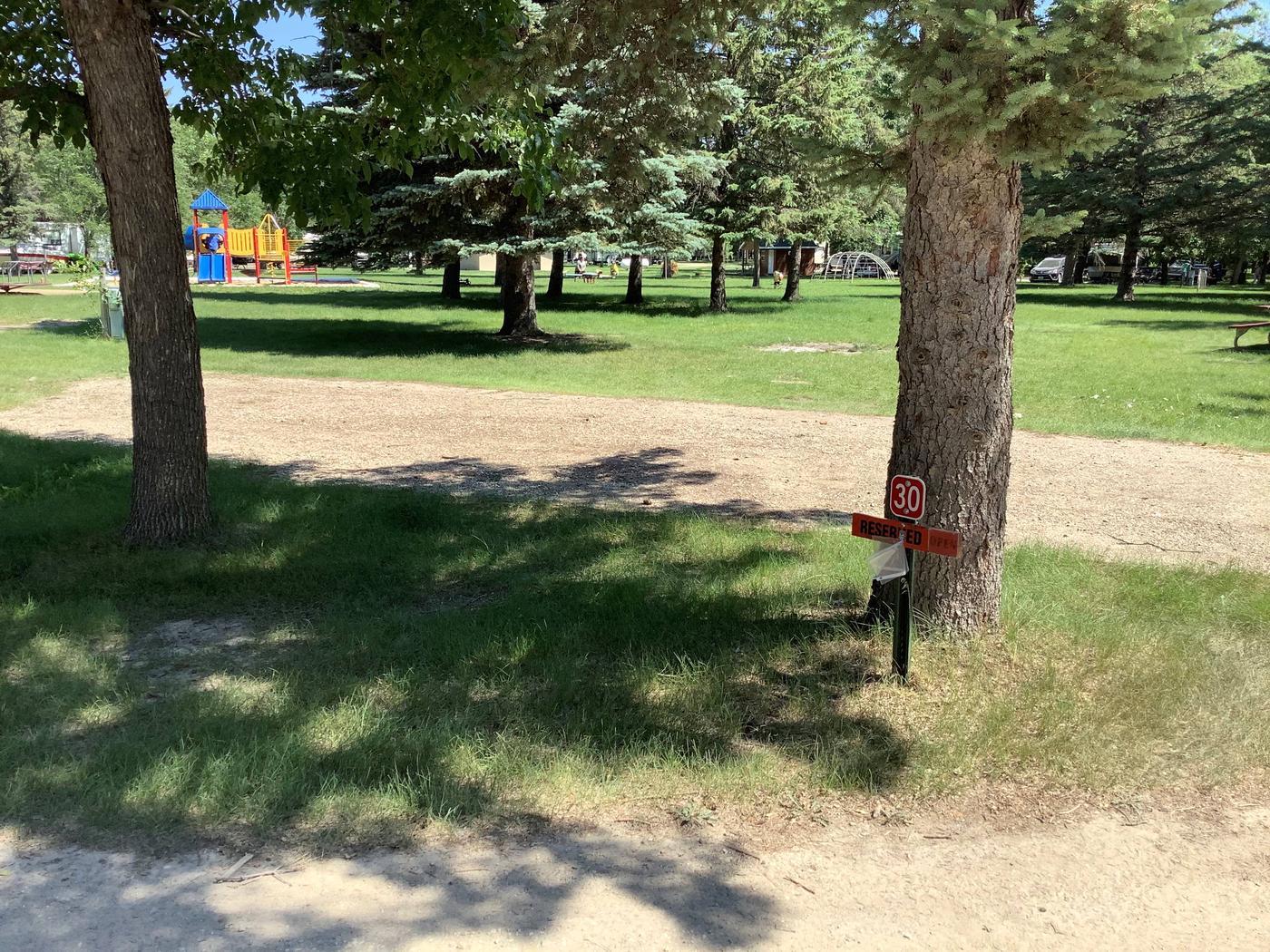 Family friendly location next to playground.Site 30
