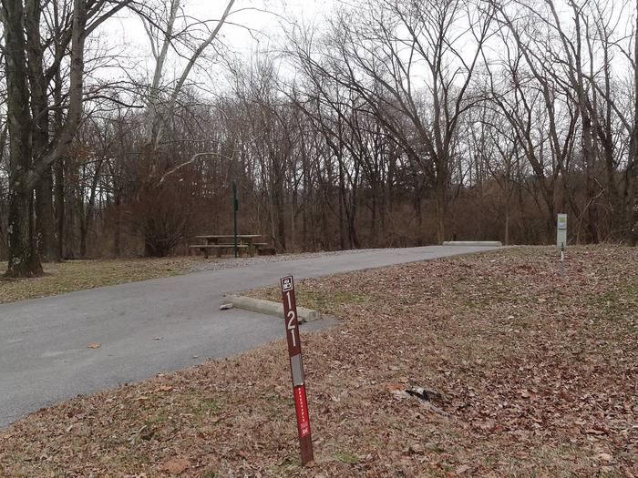 Picnic table and fire pit loacted on left side of camp pad. Electric, water, sewer located on right side. Additional parking spot loacted on right side