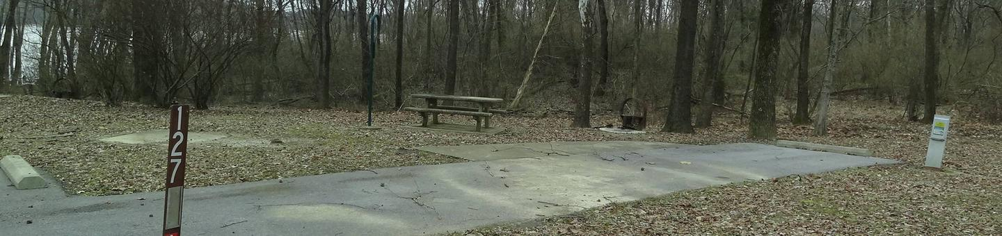 Picnic table, fire pit and extra parking located to the left of the camp pad electric locatedted on right of camp pad