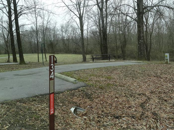 picnic table and fire pit located to the left of camp pad, electric and extra parking to the right of pad. located near bathroom