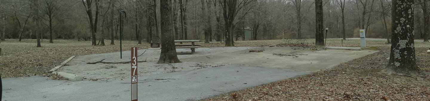 picnic table, fire pit, and extra parking located to the left of camp pad, electric, water,and sewer to the right of pad.