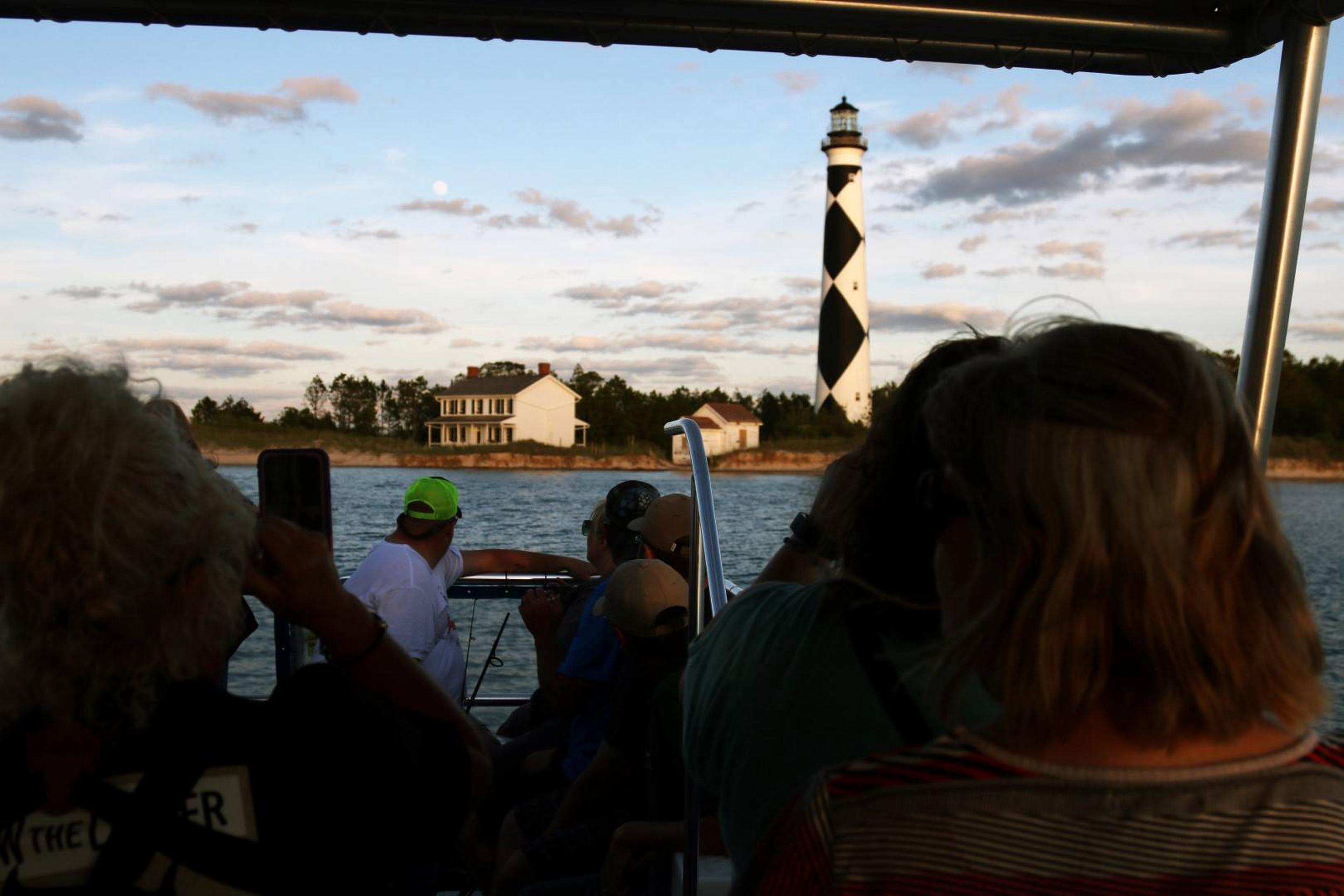 View of Cape Lookout Lighthouse Area from the ferry.Participants of the Evening at the Cape Tour arrive to the Lighthouse area, the evening's main attraction.