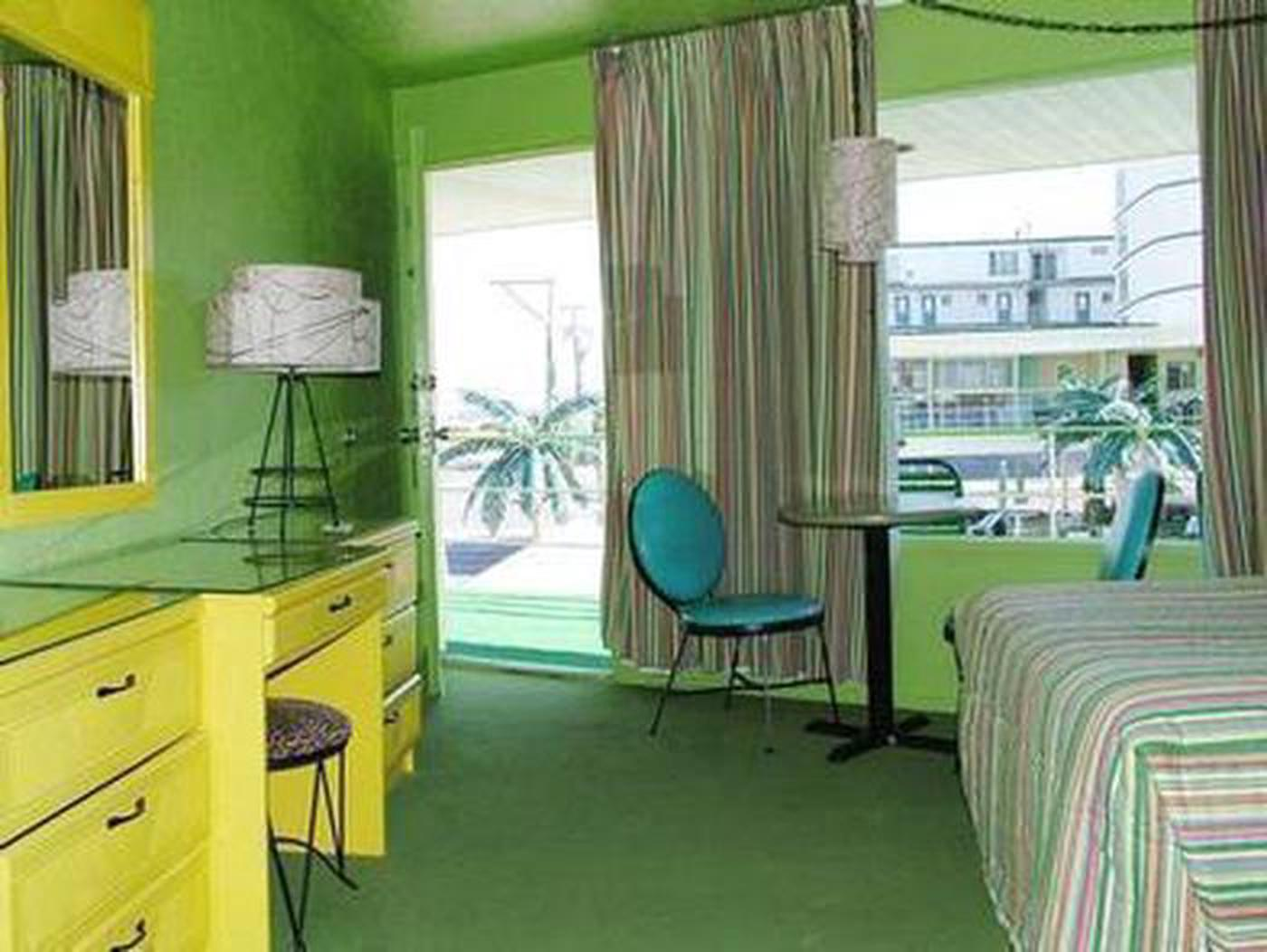 Stay at the CaribbeanThe bright green and yellow rooms at the Caribbena evoke doo-wop style while welcoming your family, from standard motel rooms, efficiencies with kitchenettes, and an ocean view suite.