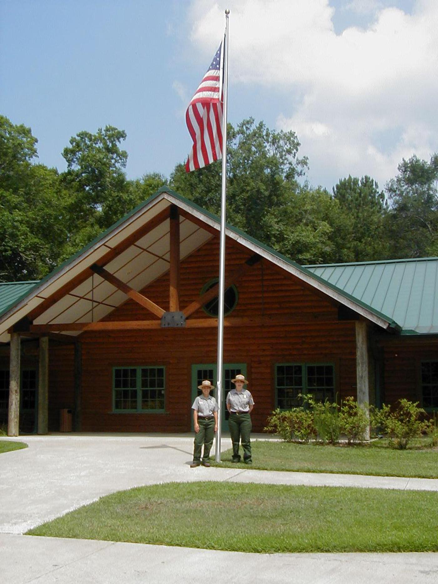 Rangers in front of visitor centerThe visitor center is open daily from 9 am to 5 pm.