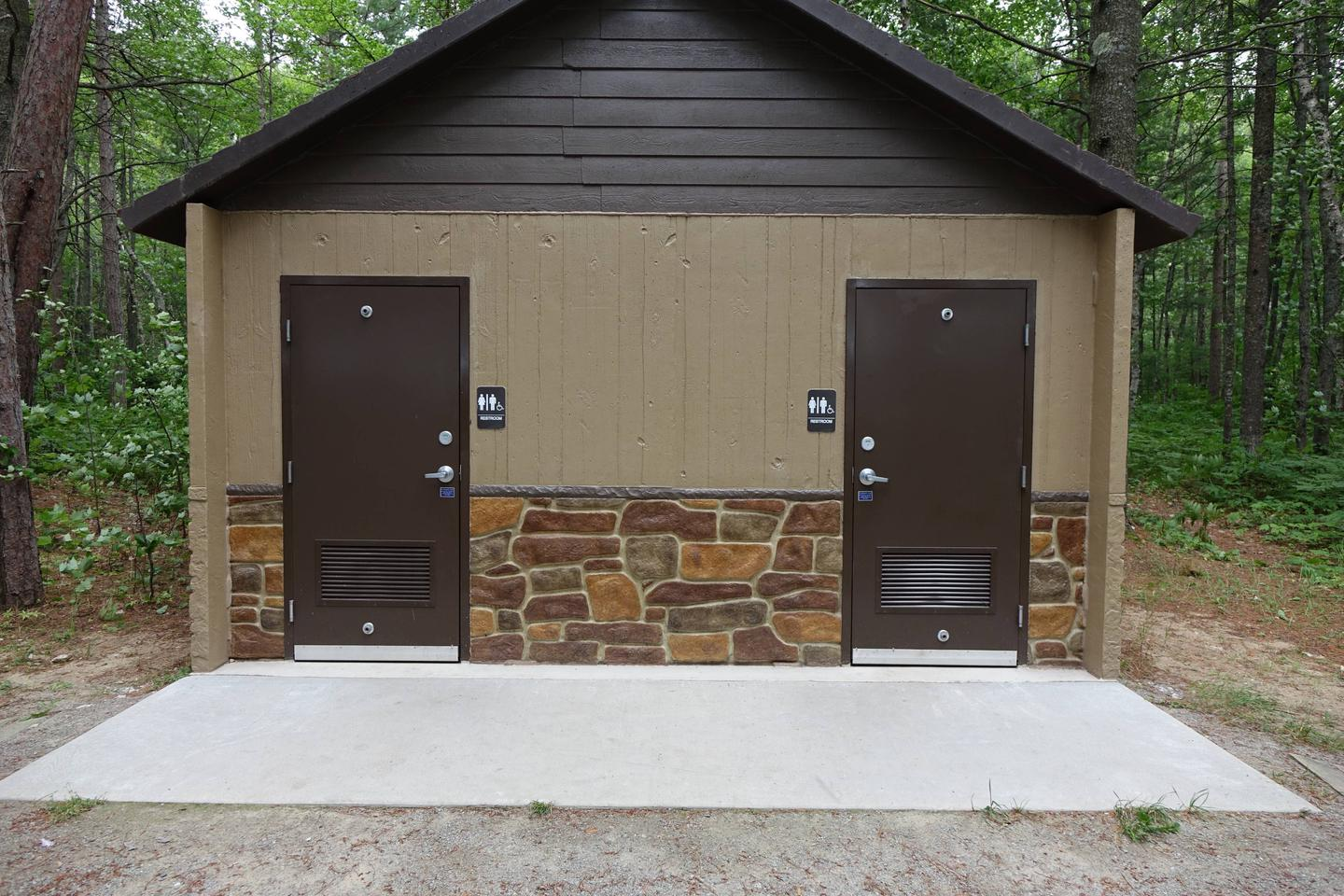 Vault restrooms at Twelve Mile CampgroundRestrooms
