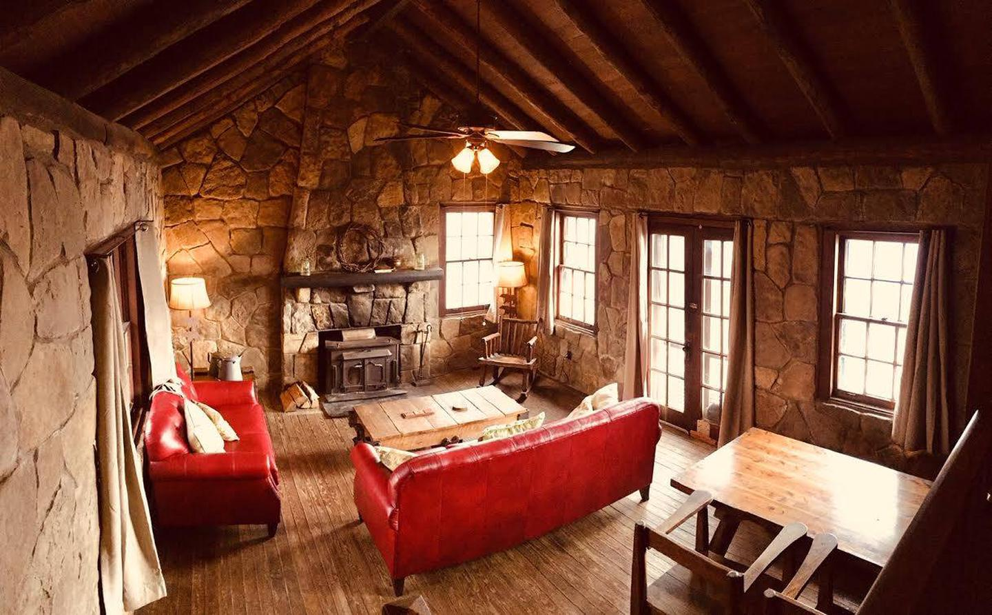 White Rock Mountain, Cabin B with new sofas.Cabin B living room with spectacular rock walls and fireplace.