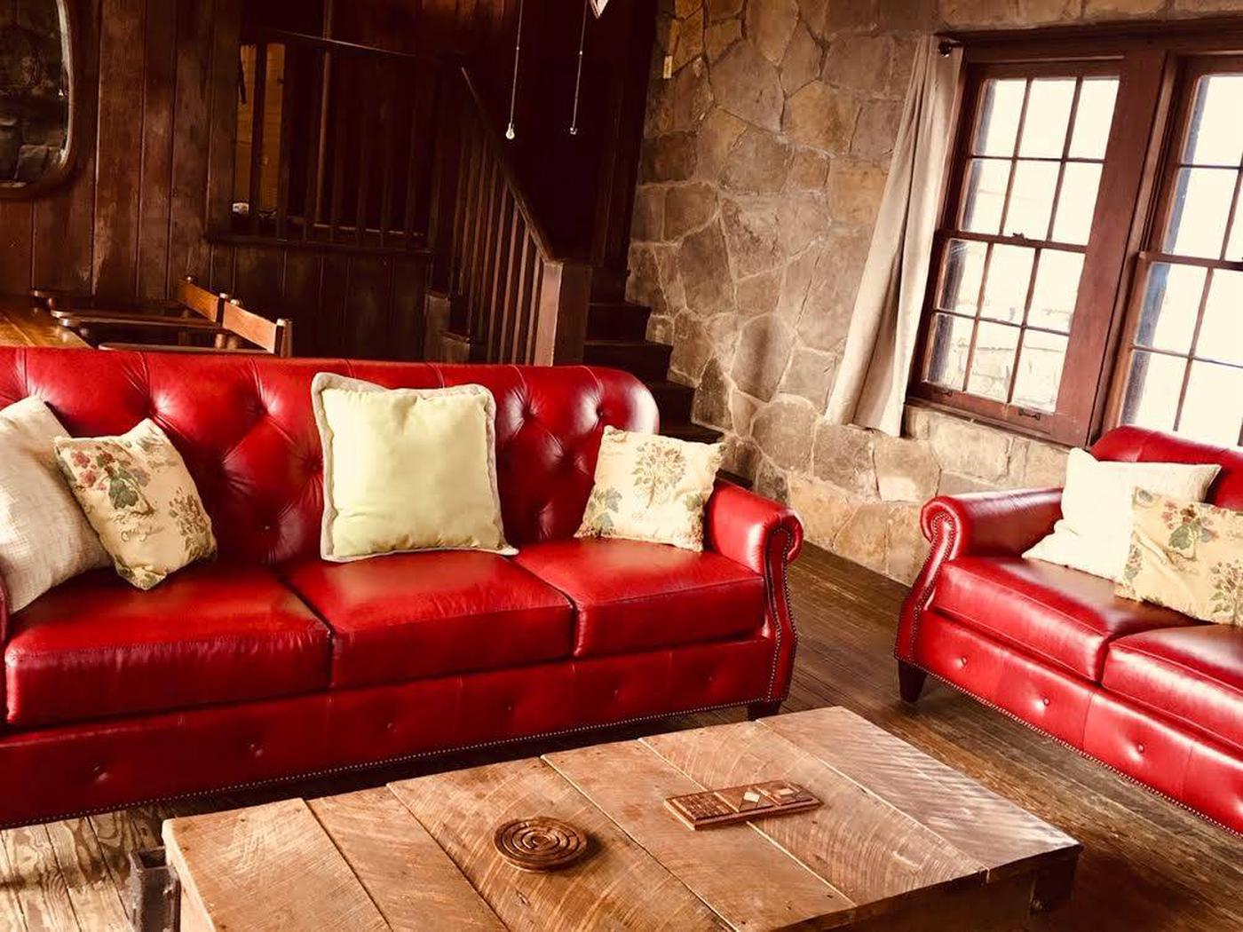 White Rock Mountain, Cabin B stairs lead down to living room.Cabin B living room with comfortable new, antique, and original CCC furnishings.