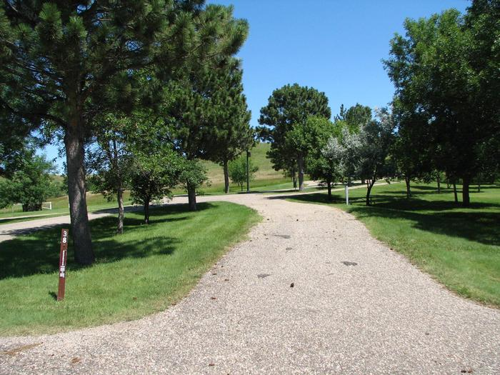 Beaver Creek Recreation Area Campsite 38- ElectricalCampsite 38 is a 30 Amp electrical pull-through campsite with a paved pad.  The campsite contains a fire ring and a picnic table.