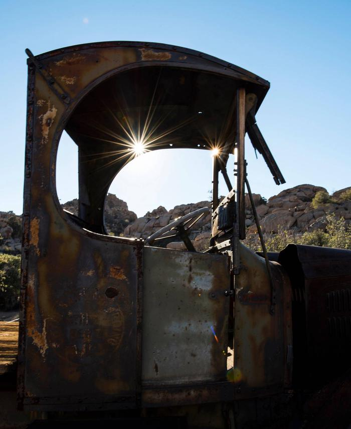 Sun streams through a rusted, old truck.Being so far from supplies and stores, the Keys family survived in the desert by making use of everything they owned.