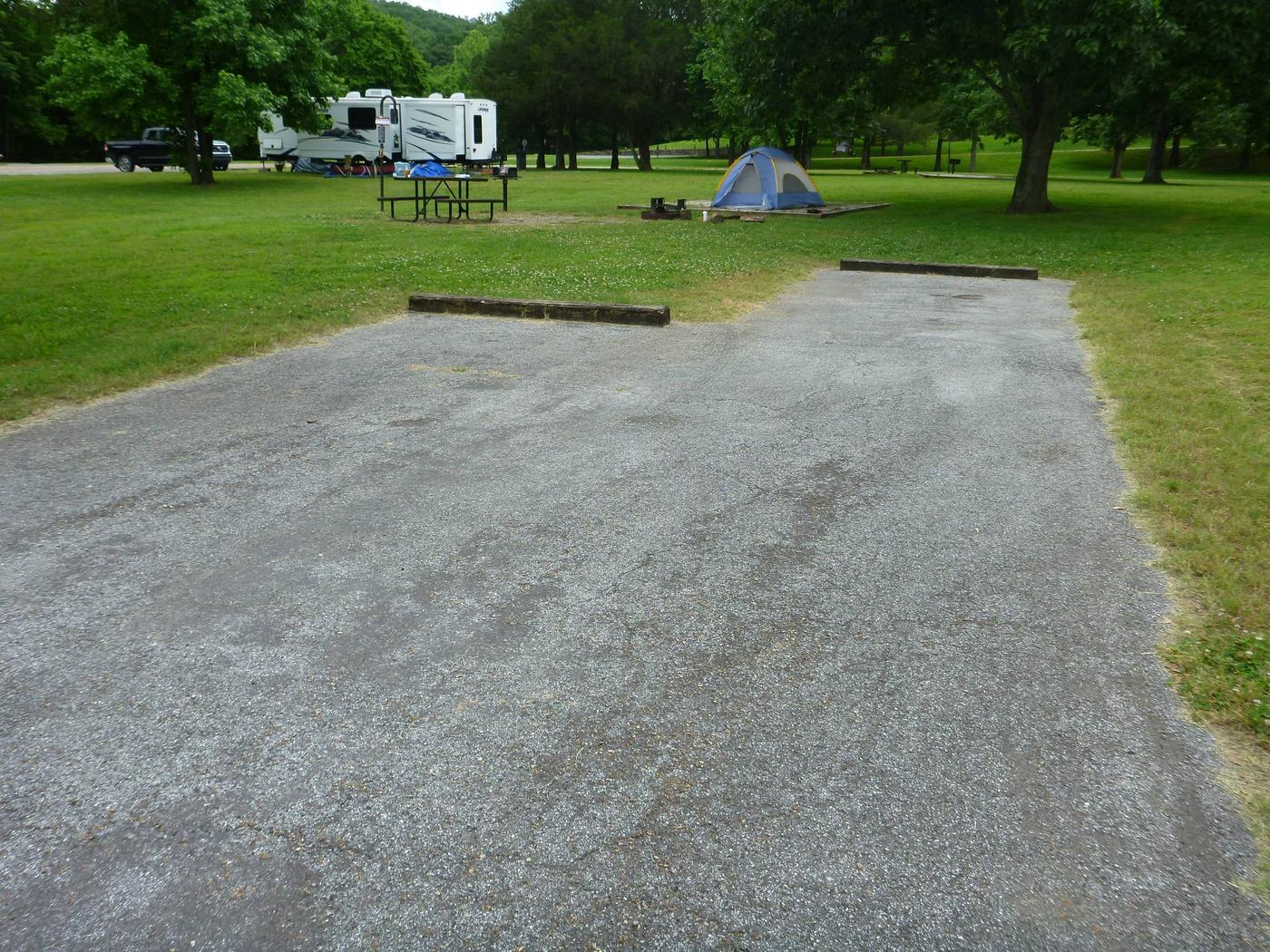 """Tyler Bend Main Loop Site# 7-1Site #7, 50"""" back-in, tent pad 15' x 15'. Parking area is wide enough for RV & car to park side by side."""