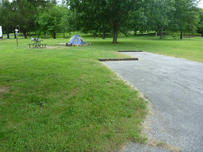 """Tyler Bend Main Loop Site# 7-2Site #7, 50"""" back-in, tent pad 15' x 15'. Parking area is wide enough for RV & car to park side by side."""