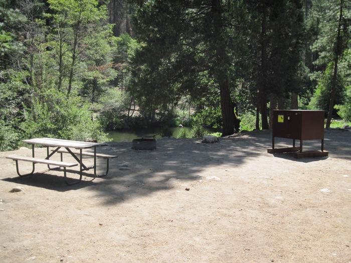 Food locker, picnic table, and fire ringSite 65