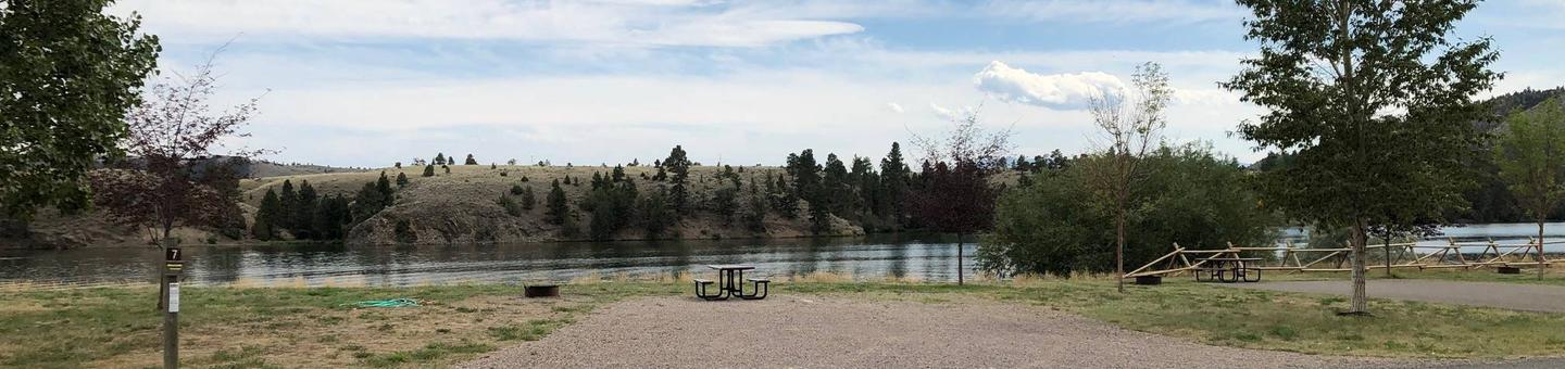 Site 7 BLM White Sandy Campground.  Lakeside campsite on Hauser Lake. Gravel camping pad with picnic table and fire pit. Paved access within campground.Site 7 BLM White Sandy Campground.