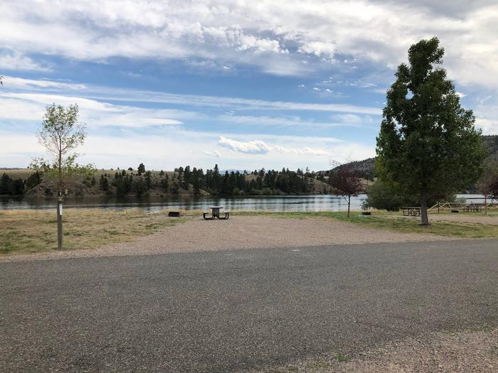 Site 9 BLM White Sandy Campground.  Lakeside campsite on Hauser Lake. Gravel camping pad with picnic table and fire pit. Paved access within campground.Site 9 BLM White Sandy Campground.