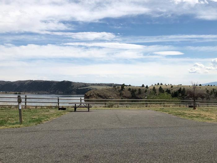 Site 23 at BLM White Sandy Campground. Paved access within campground. Paved camping pad with fire pit and picnic table. No shade at this location. Lakeside campsite on Hauser Lake.Site 23 BLM White Sandy Campground.