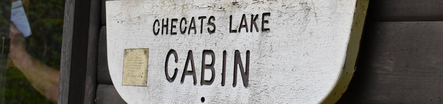 Checats Cabin bannerChecats Cabin Sign