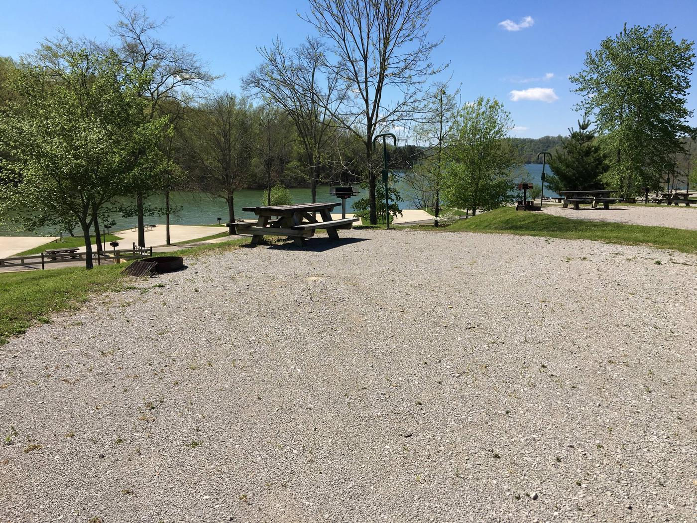 LILLYDALE CAMPGROUND SITE # 98 MID SITE VIEW WITH LAKE IN BACKGROUNDLILLYDALE CAMPGROUND SITE # 98