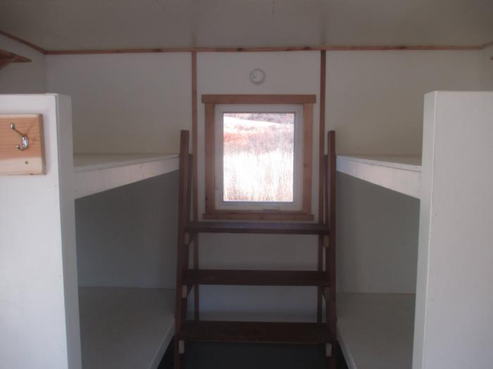 Bunk beds at rear of cabin