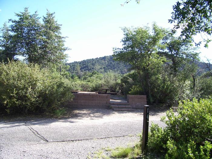 Yavapai Campground Site #14 looking SSW with three stairs to picnic table area Site #14 looking SSW