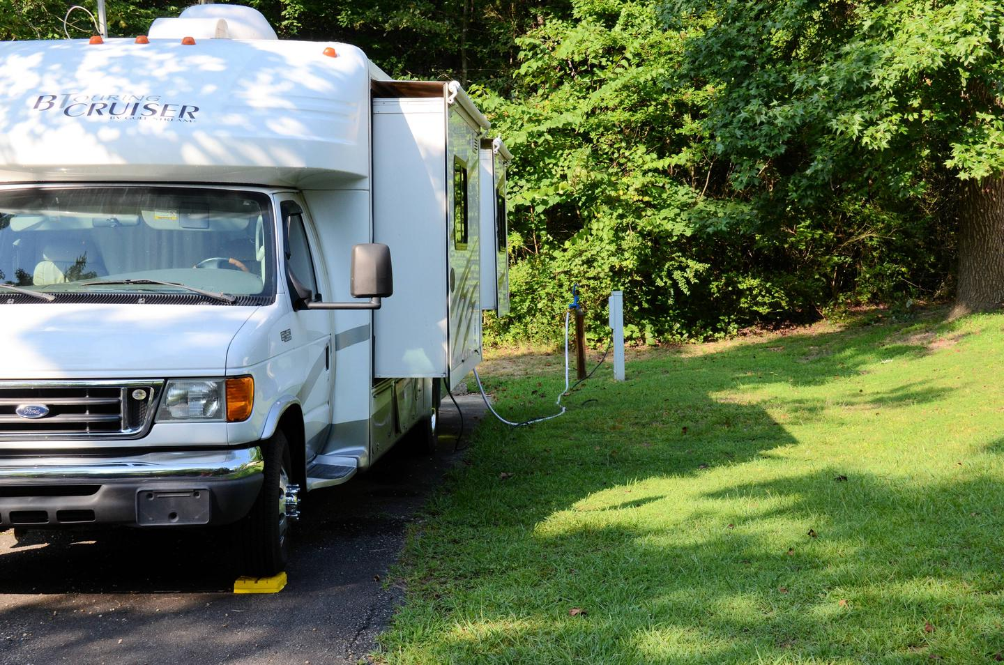Utilities-side clearance for 16.Payne Campground, campsite 15/16.  Utilities-side clearance for 16.