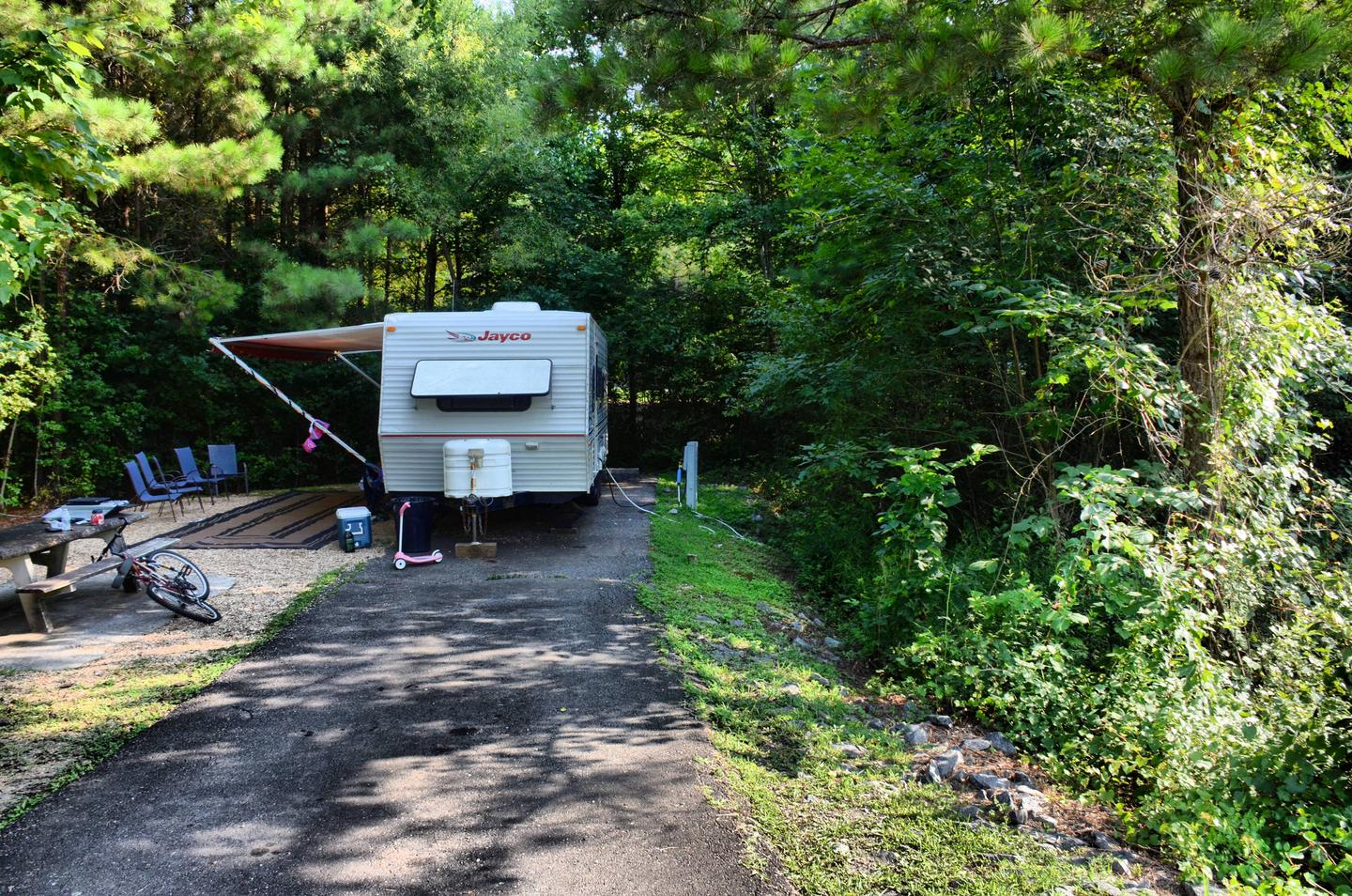 Utilities-side clearance, driveway slope.Payne Campground, campsite 22.