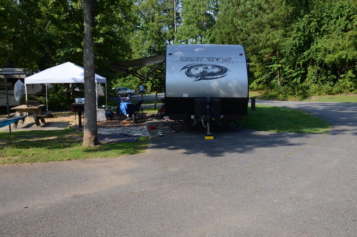 Pull-thru exit, driveway slope, awning-side clearance.Payne Campground, campsite 28.
