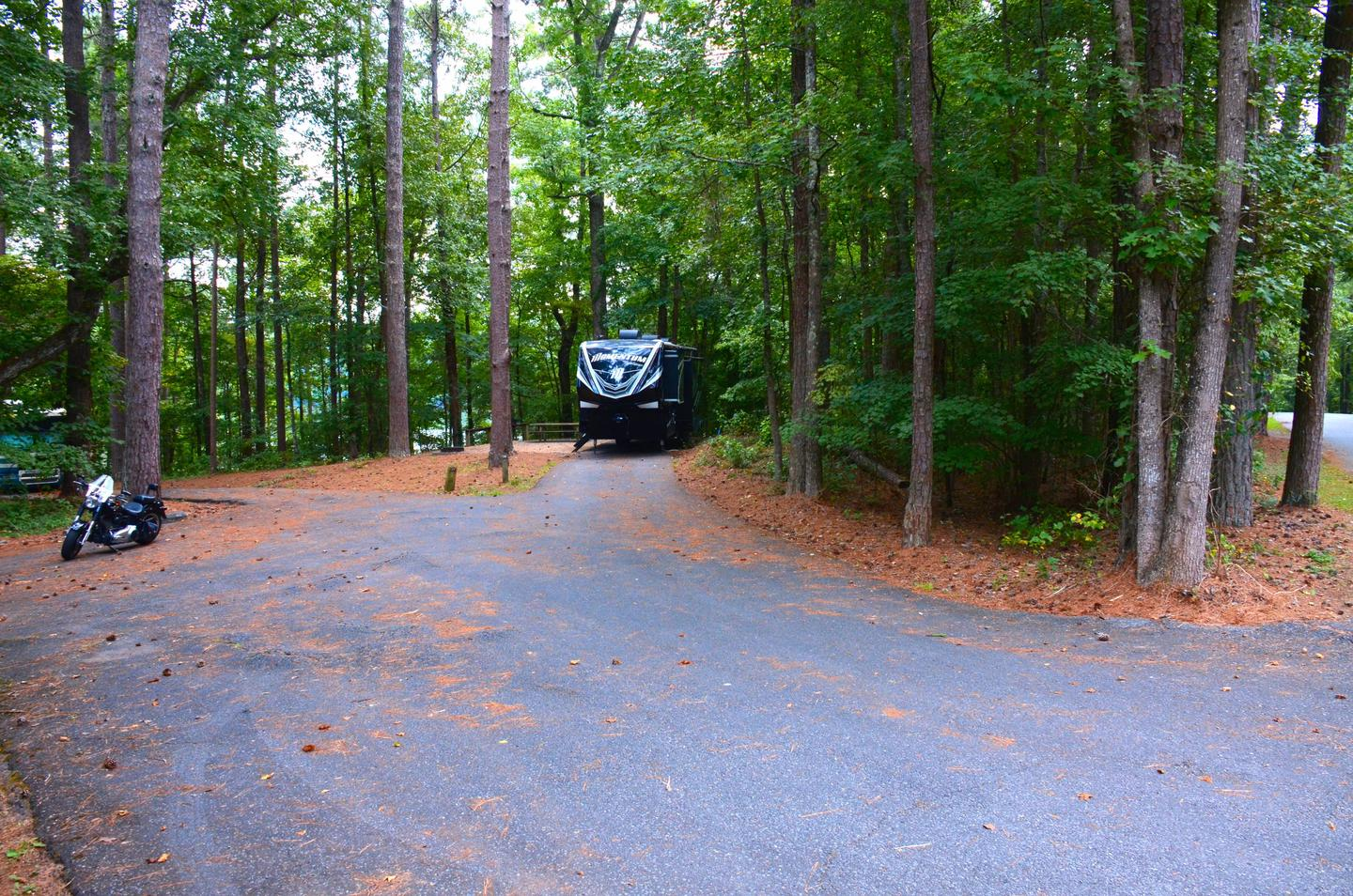 Driveway slope, utilities-side clearance.Payne Campground, campsite 38.