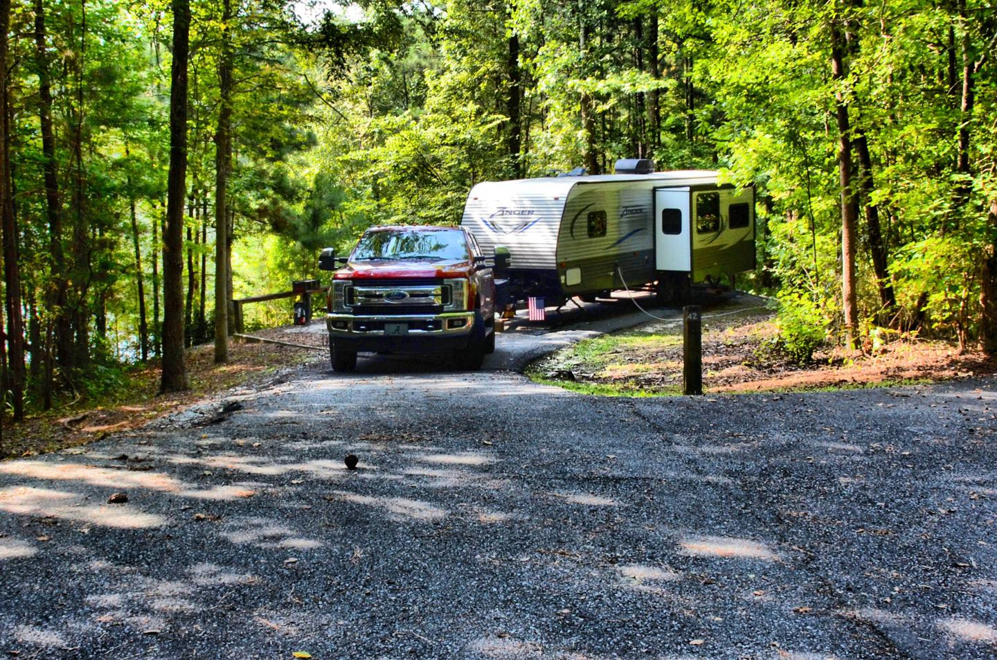 Utilities-side clearance, driveway slope.Payne Campground, campsite 42.