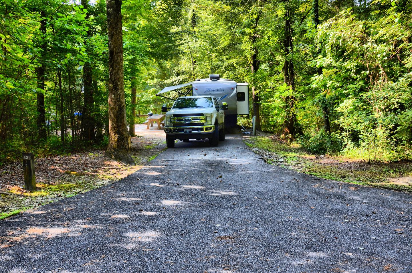 Utilities-side clearance, driveway slope.Payne Campground, campsite 43.