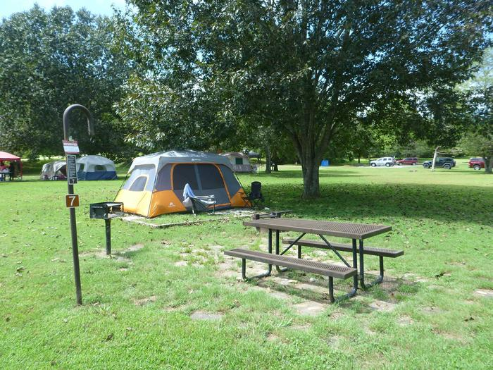"""Tyler Bend Main Loop Site# 7-3Site #7, 50"""" back-in, tent pad 15' x 15'. Parking area is wide enough for RV & car to park side by side."""