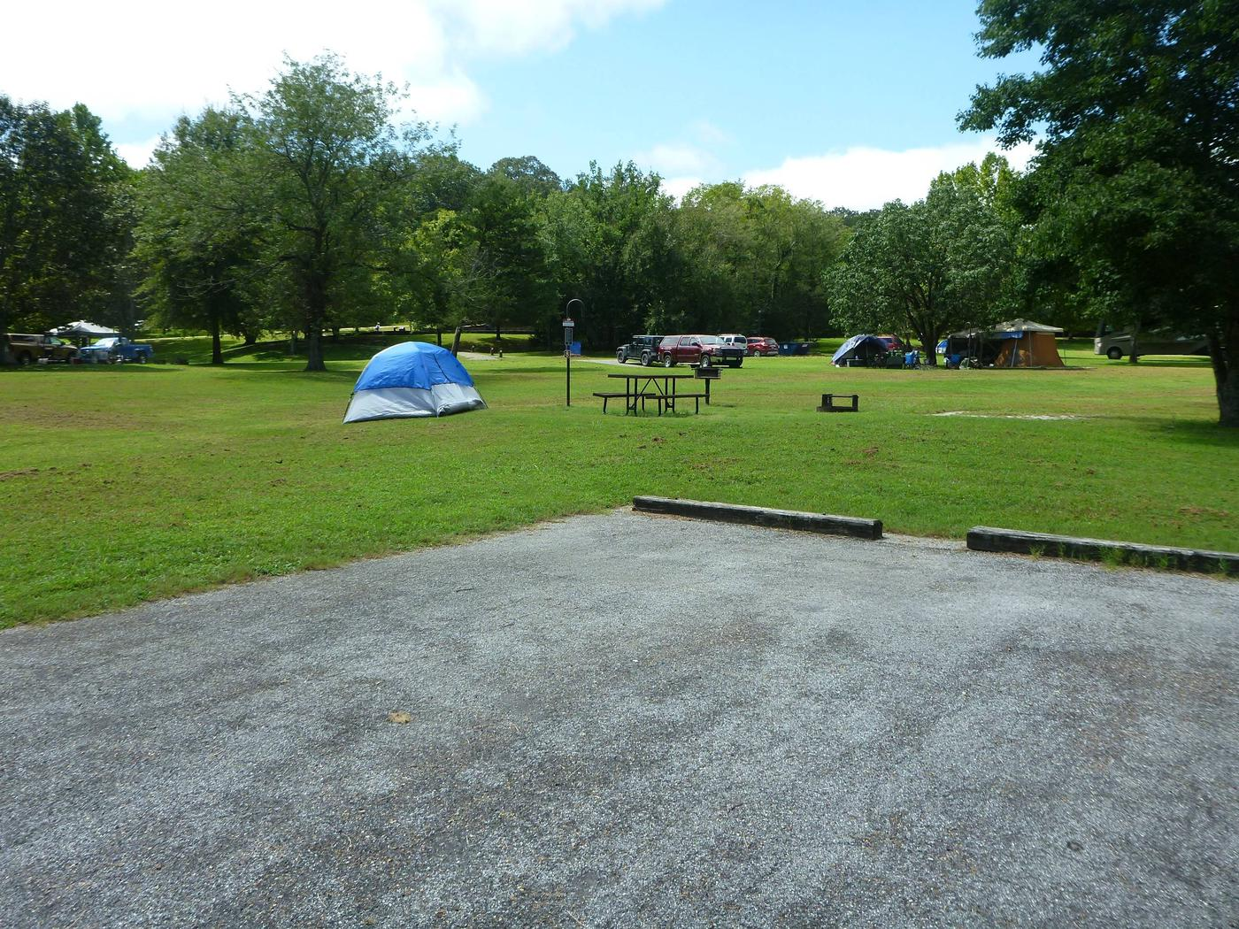 Tyler Bend Main Loop Site# 8-3 Site# 8, 35' back-in, tent pad 15' x 15'.  Parking area is wide enough to parking Rv & car side by side.