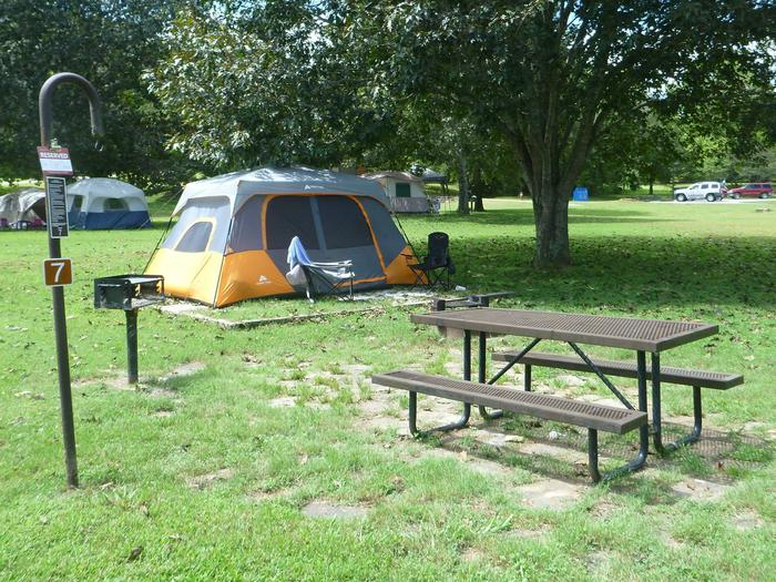 """Tyler Bend Main Loop Site# 7Site #7, 50"""" back-in, tent pad 15' x 15'. Parking area is wide enough for RV & car to park side by side."""