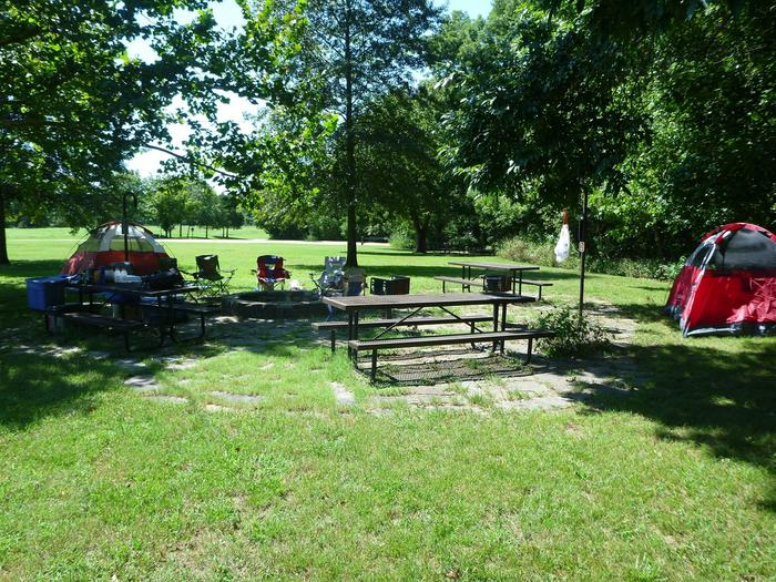 Group Site 2Group Site #2, Three picnic tables; two lantern holders; two charcoal cooking stands; one large fire pit.