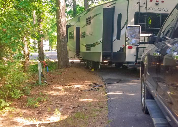 Pull-thru entrance, utilities clearance.Victoria Campground, campsite 12.