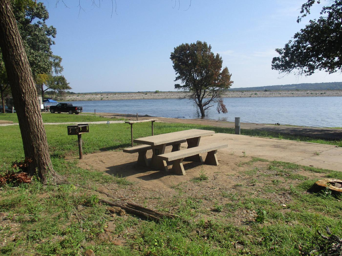 Site 41 - Taylor FerrySite 41 offers a concrete picnic table, utility table, pedestal grill and fire ring.