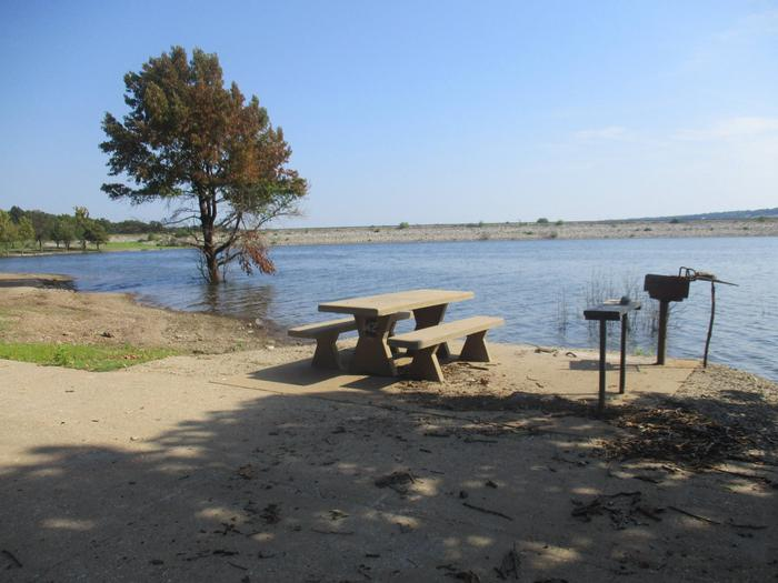 Site 42 - Taylor FerrySite 42 offers a concrete picnic table, pedestal grill, utility table and fire ring.