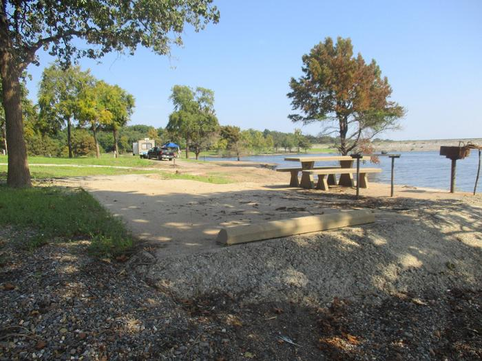 Site 42 drive - Taylor FerrySite 42 offers a concrete parking pad, but is best suited for smaller camping units.