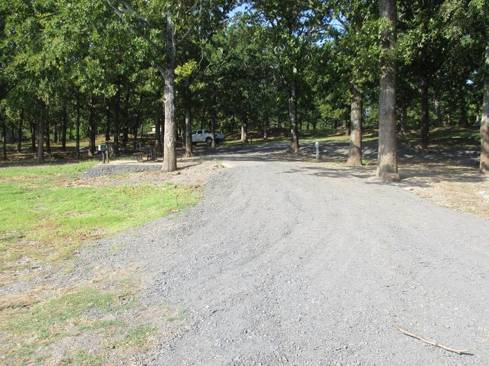 Site 50 drive - Taylor FerrySite 50 offers a gravel drive to a concrete parking pad.