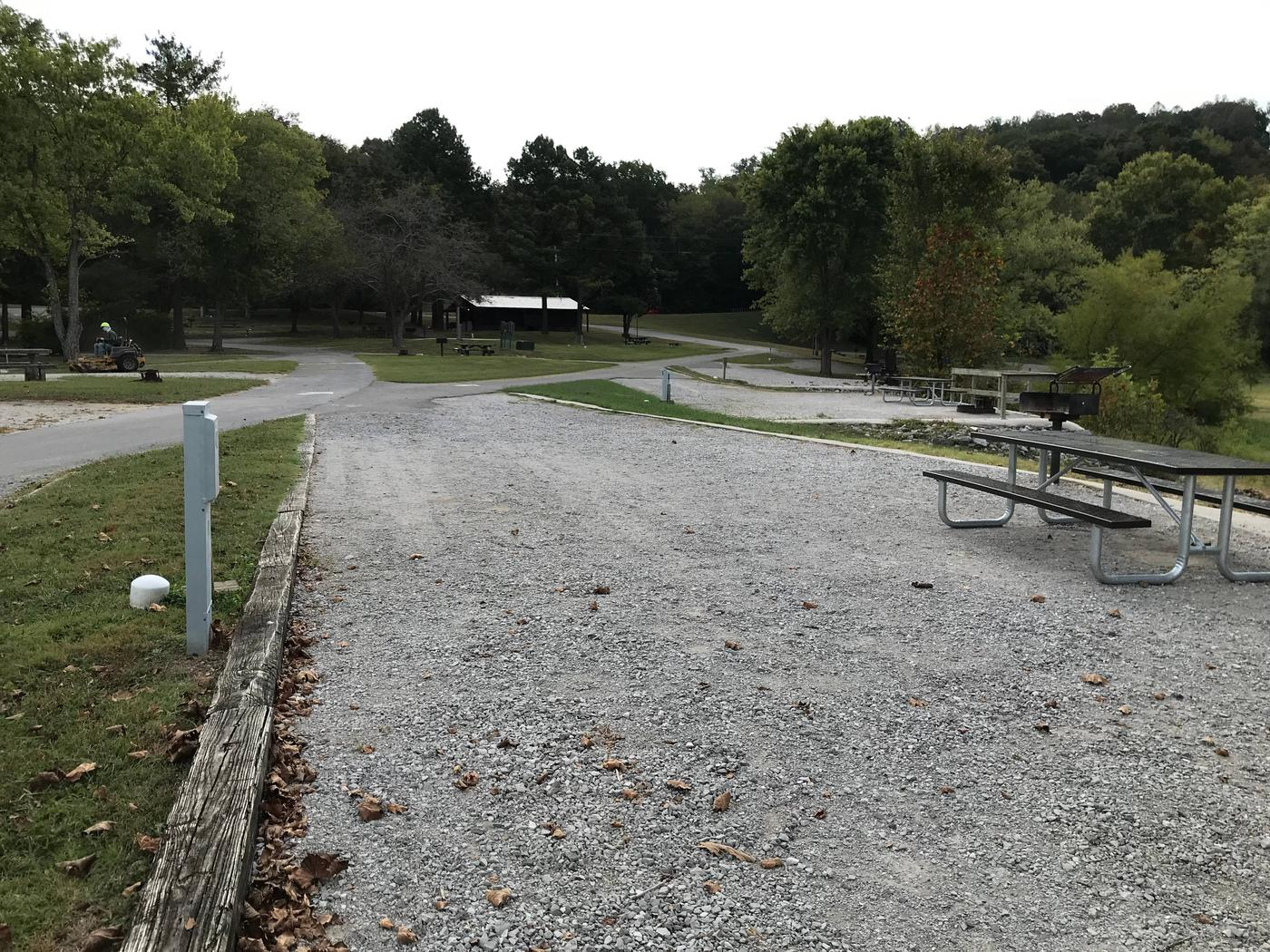 OBEY RIVER PARK SITE # 42 LONG VIEW TOWARD ROADOBEY RIVER PARK SITE # 42 WHITE CAP IS WATER VALVE, NOT SEWER