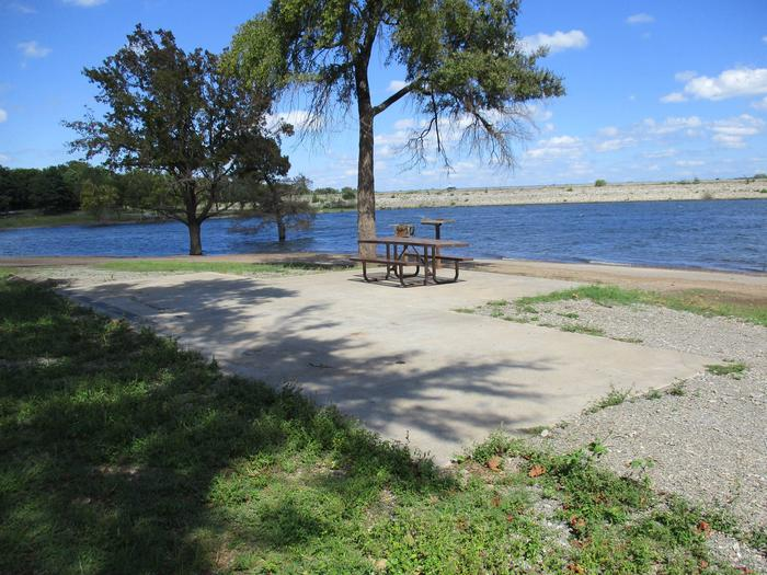Site 44 - Taylor FerrySite 44 offers a gravel drive with a concrete parking pad.  It has a great lake view and easy access to the water.