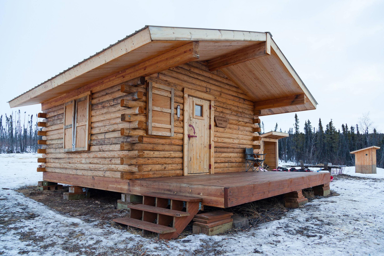 A log cabin in a snowy meadowMoose Creek Cabin in winter