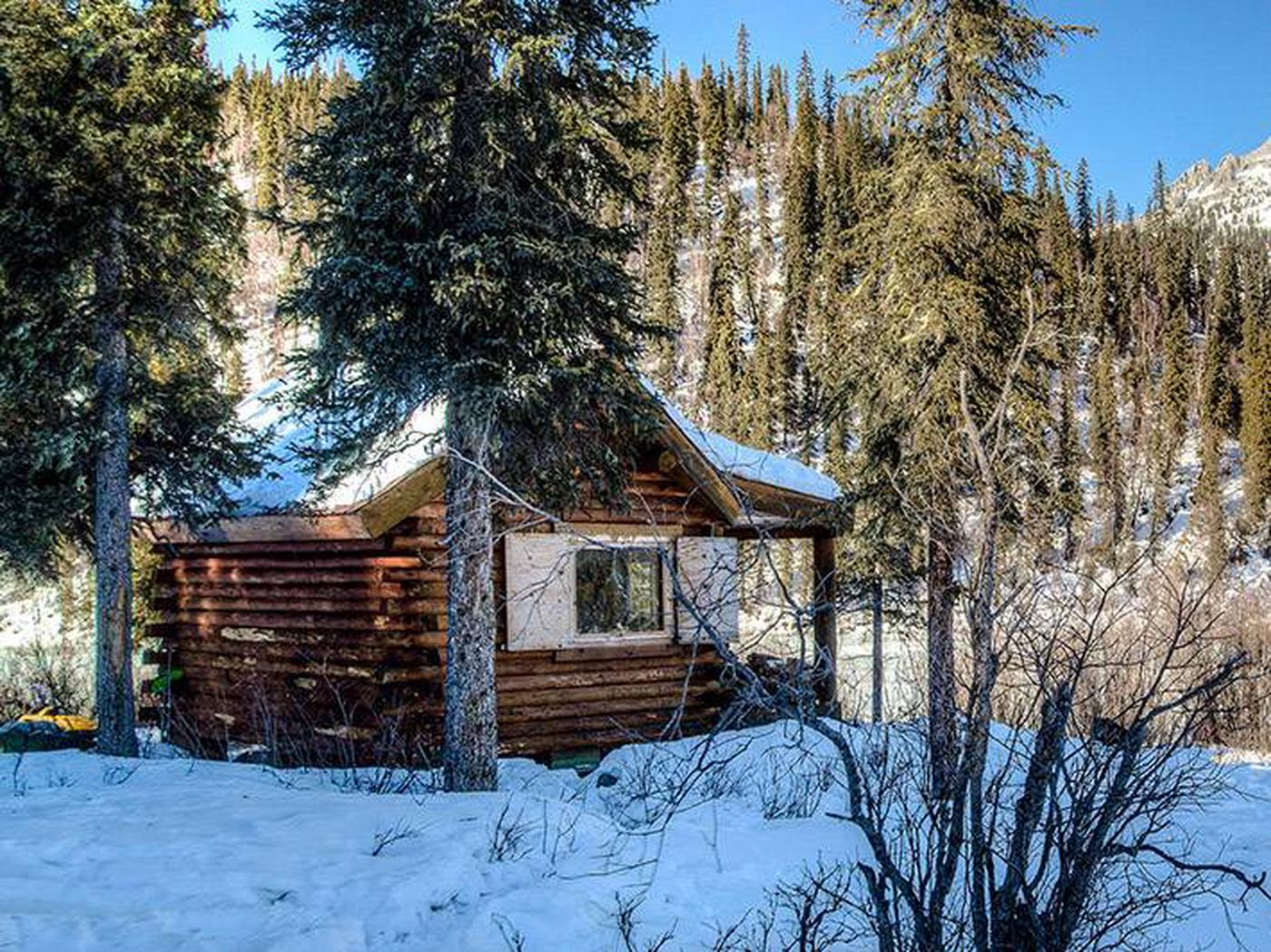 Log cabin in front of forested hillWindy Gap Cabin