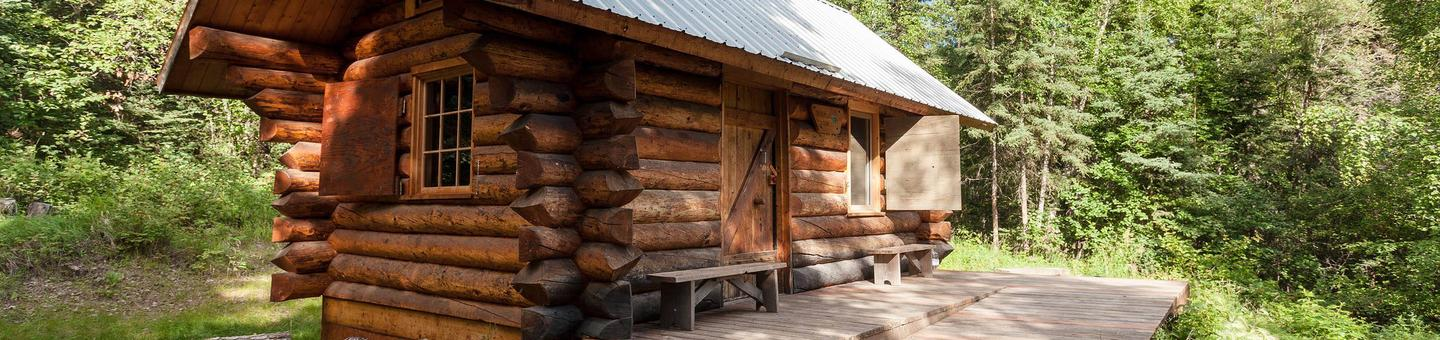 Front and side view of a log cabin Fred Blixt Cabin