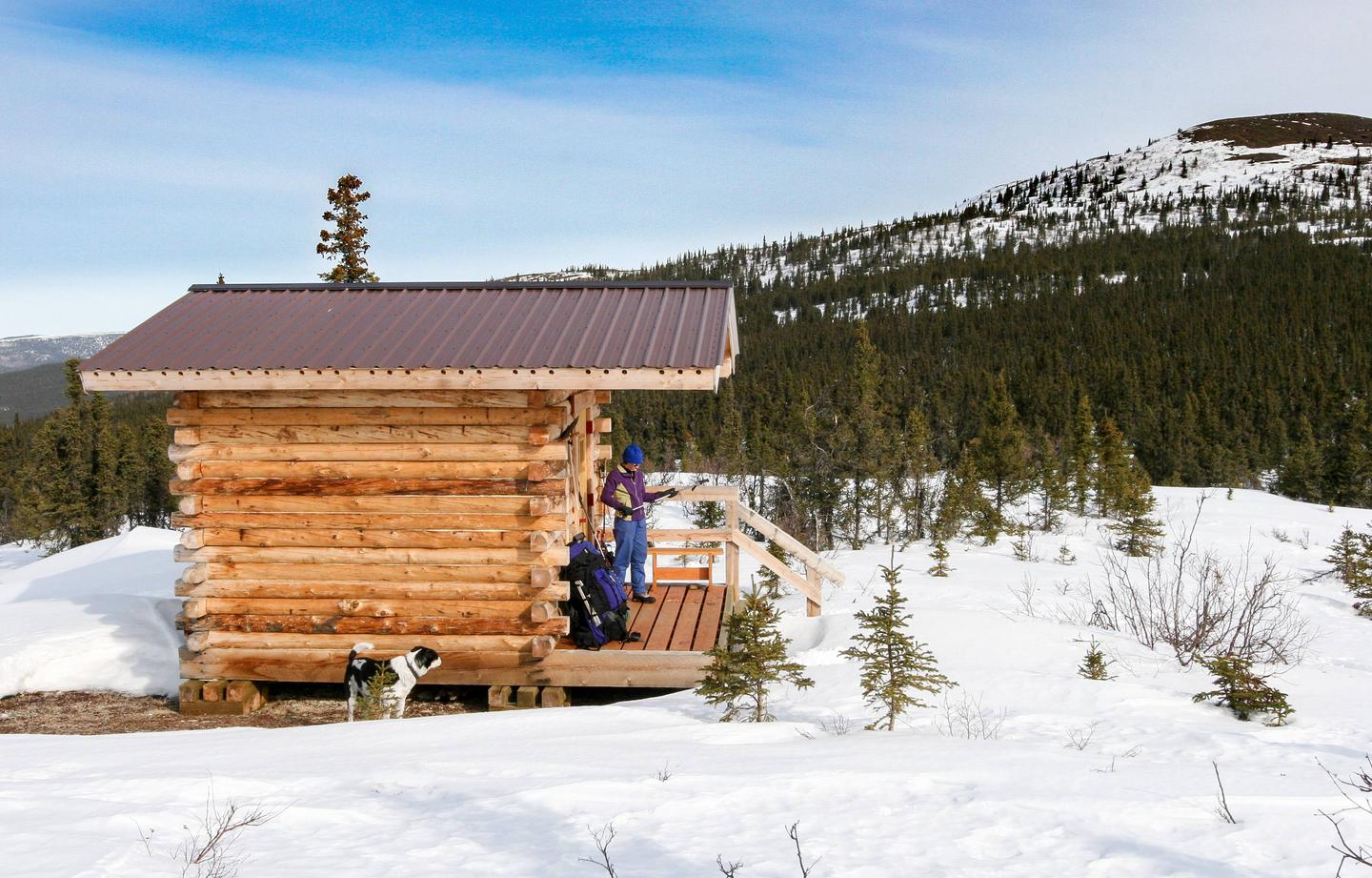 A small cabin on a wooded ridge in winterSummit Trail Shelter in winter.