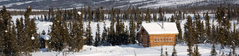 Cabin next to a frozen lakeColorado Creek Cabin