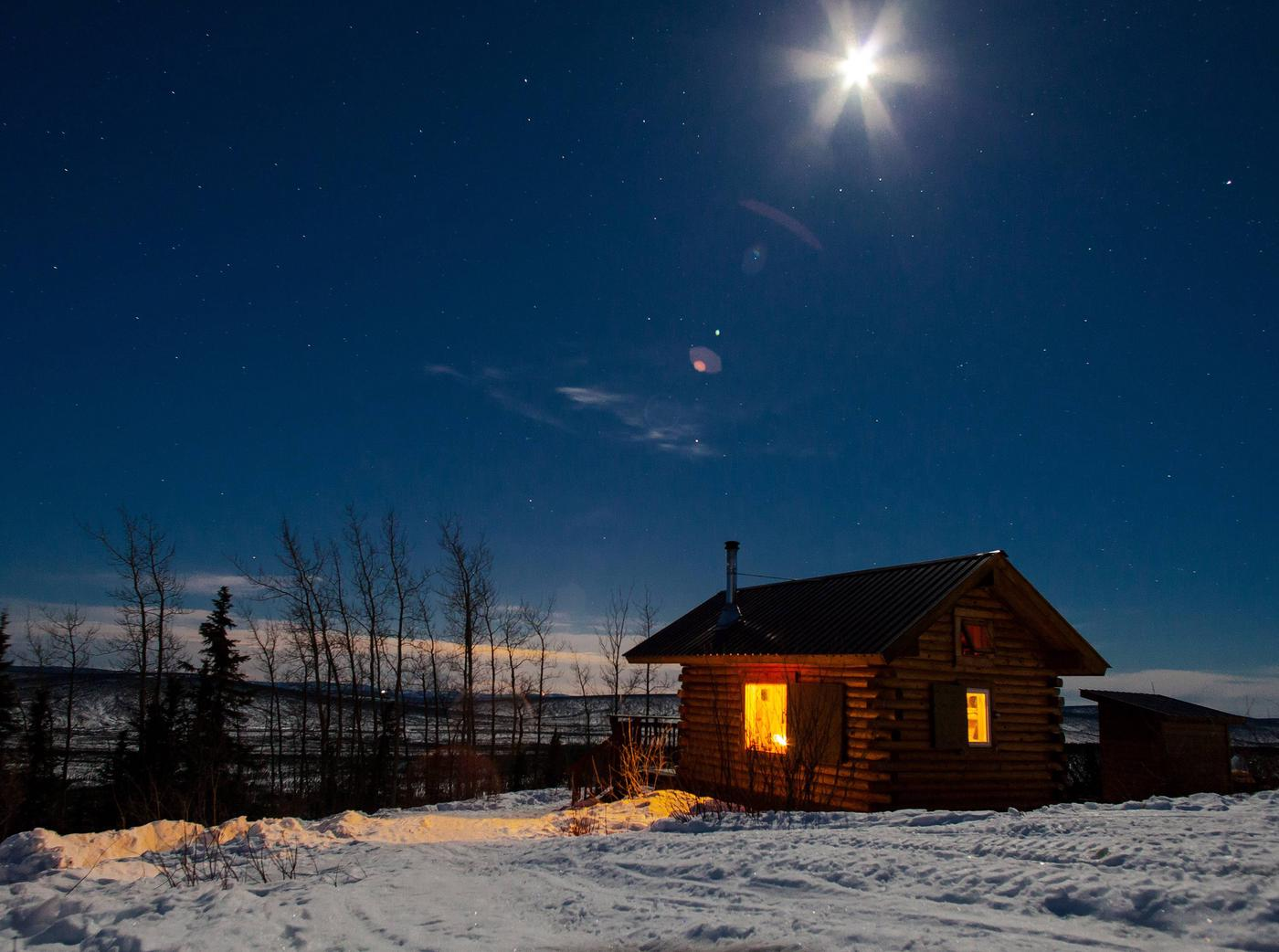 Log cabin at night under moonlightEleazar's Cabin under moonlight
