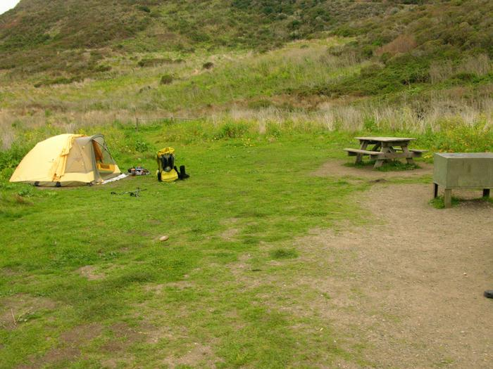 Campsite with picnic table, food storage locker, and charcoal grill.Wildcat 2AB