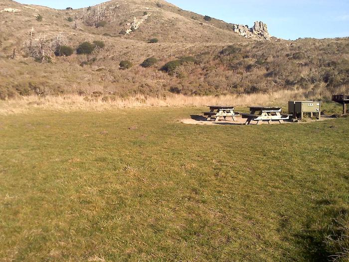 Campsite with picnic table, food storage locker, and charcoal grill.Coast 13AB