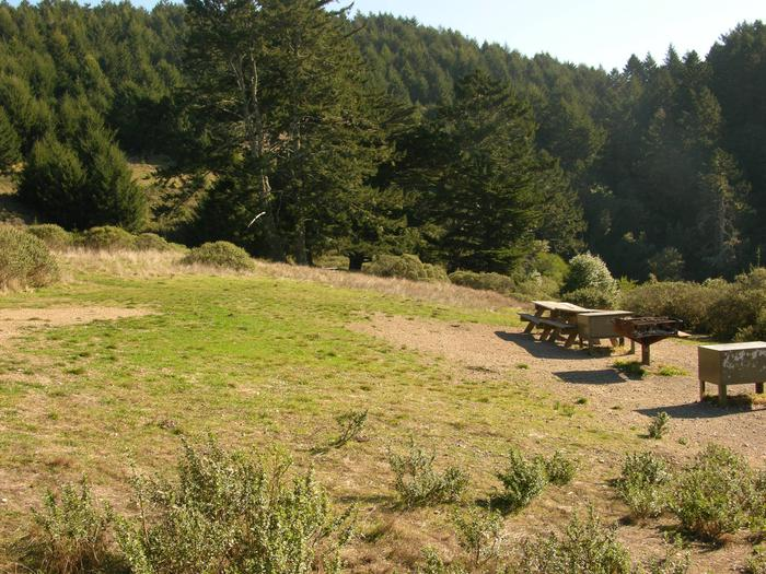 Campsite with picnic table, food storage locker, and charcoal grill.Sky 2AB